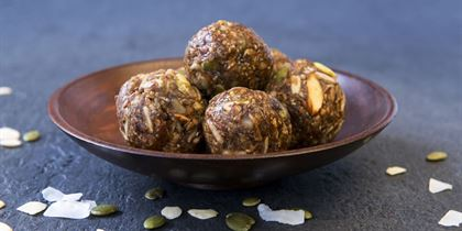 Raw vegan protein ball - pumpkin & sunflower seeds, chia, linseed, date, raw almond, peanut, oat, vanilla pea protein, agave, maca vgn